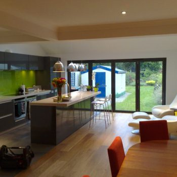 Kitchen with wooden under floor heating looking out into the garden