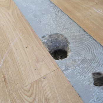 Under amtico flooring heating repair with flooring removed with hole in concrete floor