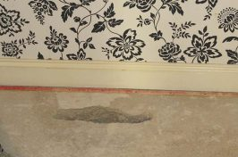 Under carpet heating repair with hole in concrete floor