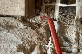 Underfloor heating repair with frayed red wire
